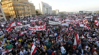 People-carry-lebanese-national-flags-and-chant-slogans-as-they-take-part-in-an-anti-government-protest-at-martyrs-square-in-downtown-beirut-lebanon_5405379